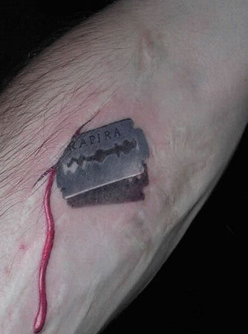 12/11 » 91 Razor Blade Cut Tattoo