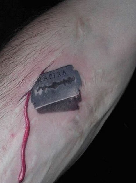 91 Razor Blade Cut Tattoo